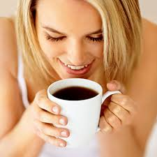 Woman taking coffee - Beverages such as tea and coffee are common causes of