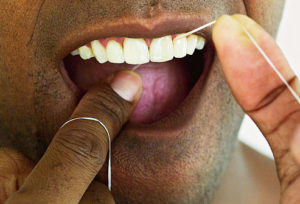How to floss teeth to prevent teeth stains
