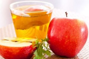 Apple cider vinegar fruit and juice in a glass