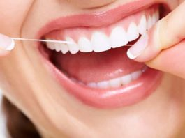 How to make teeth stronger - floss daily