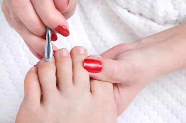 Moisturize your toenails to prevent white spots