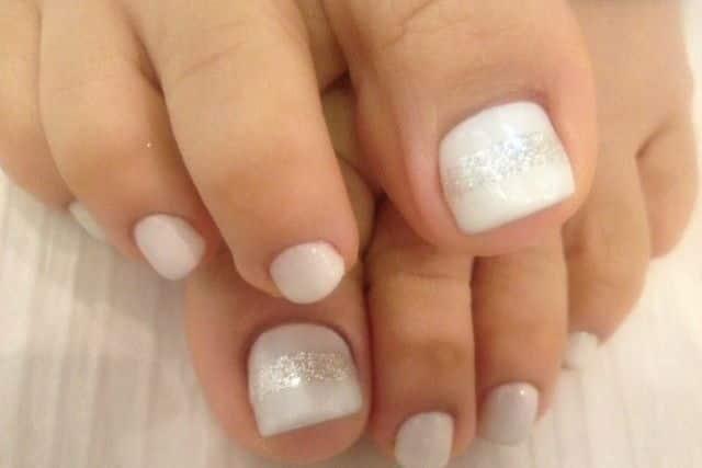 Polish toenails to get rid of white spots